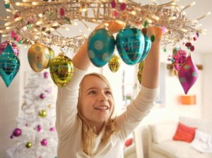 Girl Hanging Christmas Ornaments --- Image by © Jutta Klee/Corbis